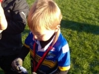 Archie L receives his first ever rugby medal