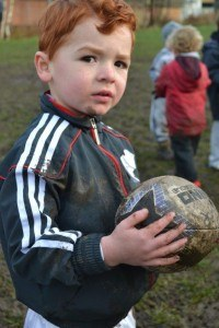 Roman looks candidly with rugby ball in hand LLR Dec2103